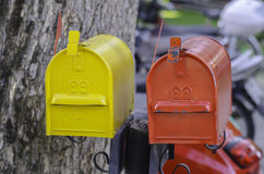 Yellow and red mailboxes Royalty Free Stock Photos
