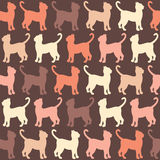 Yellow and red, orange  silhouette cats seamless pattern. Cats pattern over  brown background. Simple vector texture Royalty Free Stock Images