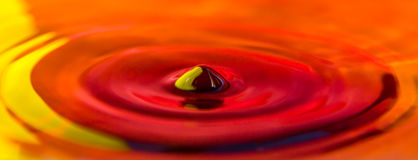 Yellow Red and Orange Splash Water Drop royalty free stock photography