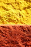 Yellow red paint wall background or texture Stock Image
