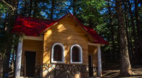 Yellow and Red Painted Wooden House Stock Image