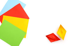 Yellow and red paper boats, origami, paper sheets, color paper sheets. Stock Photo
