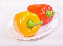 Yellow and red peppers. Isolated on white background Royalty Free Stock Photography