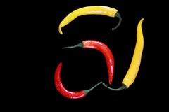 Yellow and red peppers Royalty Free Stock Image