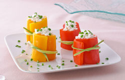 Yellow and red peppers with cheese, appetizer Royalty Free Stock Photo
