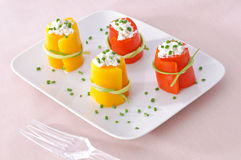 Yellow and red peppers with cheese and chive Royalty Free Stock Photo