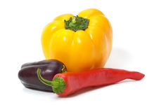 Yellow and red peppers with eggplant isolated Royalty Free Stock Photography