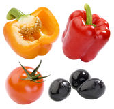 Yellow and red peppers, tomato and black olives Royalty Free Stock Photo