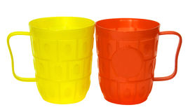 Yellow and red plastic glasses Stock Photos