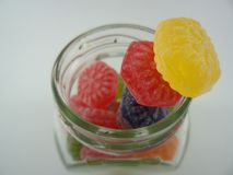Colorful candies in a glass jar. Yellow, red, purple and green  candies Stock Photos