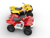 Yellow and red quad bikes - top side view Royalty Free Stock Photos