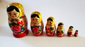 Series of russian matrioska. Yellow and red russian matrioska in serie from taller to smaller stock photos