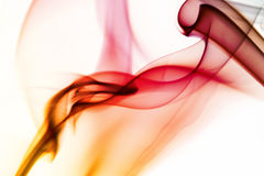Yellow and red smoke. In white background royalty free stock photos