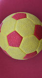 Yellow red soccer ball texture Stock Images
