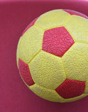 Yellow red soccer ball texture Royalty Free Stock Image