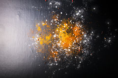 Yellow and red spices, sea salt and color pepper on a black back Stock Image