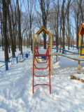 Yellow-red staircase in a children's snow park area of ​​the city Stock Image