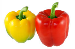 Yellow and red sweet pepper. A yellow and a red sweet pepper stock photo