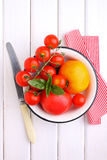 Yellow and red tomatoes, basil and mozzarella cheese. On a white wooden table Stock Photography