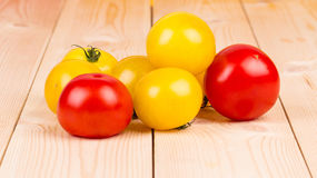 Yellow and red tomatoes on the wood. Stock Photography