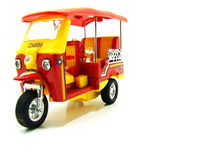 Isolated yellow and red tuk-tuk stock photos