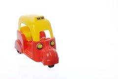 Yellow and red tuk-tuk Stock Image