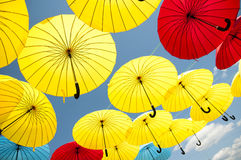 Yellow and red umbrellas. Stock Photo