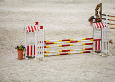 Yellow red white obstacle for jumping horses. Riding competition. Royalty Free Stock Photos