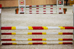 Yellow red white obstacle for jumping horses. Riding competition. Royalty Free Stock Photo