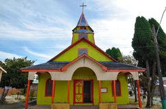 Yellow and red wooden church in Quemchi royalty free stock image