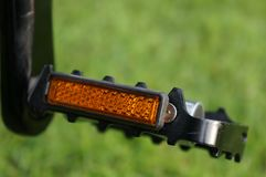 Yellow reflective , Black aluminum alloy bike pedals on the bicycle royalty free stock photography