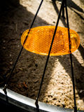 Yellow reflector. Yellow bicycle reflector on black spokes stock photography