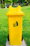 Yellow refuse bin in park Royalty Free Stock Photography