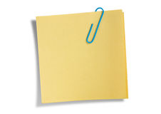 Yellow remainder note isolated. On white background, with blue clip Stock Image
