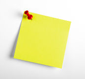 Yellow reminder note with red pin. On the white background royalty free stock photos