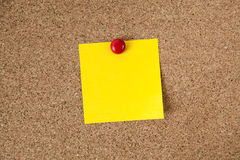 Yellow reminder sticky note on cork board, empty space for text Royalty Free Stock Images