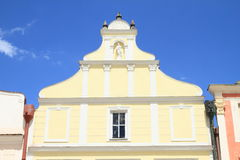 Yellow renaissance house with statue in Telc Stock Photography