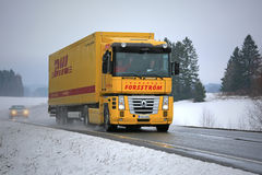 Yellow Renault Magnum Semi Truck Hauls in Winter Royalty Free Stock Images