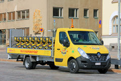 Yellow Renault Master Flatbed Van Hauls City Bikes Stock Photography