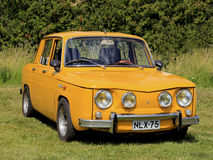 Yellow Renault 8S Car Parked on Grass stock photography