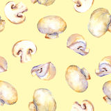 Yellow repeating pattern with natural mushrooms champignon Royalty Free Stock Image