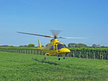 Yellow rescue helicopter air ambulance takes off Royalty Free Stock Images
