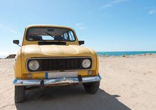 Yellow retro car by the sea Royalty Free Stock Photography