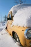Yellow retro car under the thick stratum of snow Royalty Free Stock Photo
