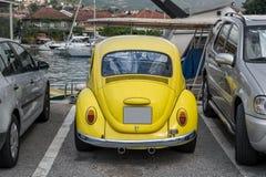 Yellow retro car at yacht marina Royalty Free Stock Images