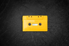 Yellow retro Cassette tape over blackboard. top view. Stock Images