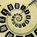 Yellow retro old clock spiral abstract background. Antique clock fractal background. Time spiral surreal clock stock photography