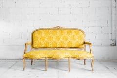 Yellow Retro Sofa Stock Photography