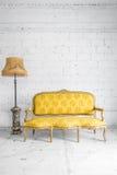 Yellow Retro sofa with lamp Royalty Free Stock Photos