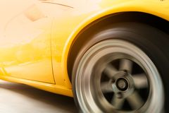 Retro car. Yellow retro sport car running on highway with fast speed motion blur Royalty Free Stock Photography